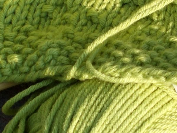 Close-up of the green Cotton Ease worked in seed stitch