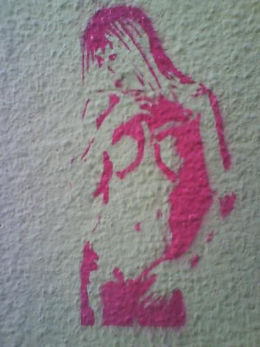 Pink woman stencil graffiti