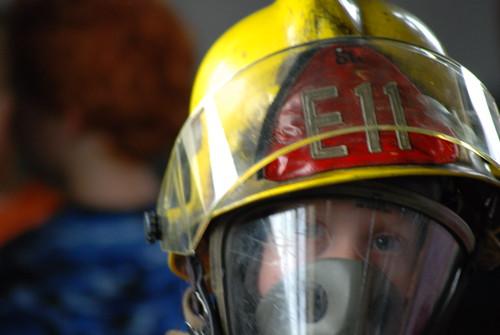 boy in fireman helmet