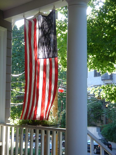 Flag hanging on the front porch