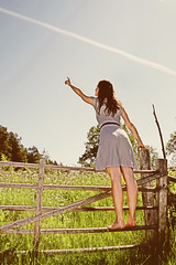 """Look!"" (Stefan Sderstrm) Tags: flowers blue summer sky sun girl look field grass fence gate paradise dress flight meadow retro barefoot pointing meadowflowers"