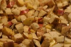 Potatoes, rosemary and garlic ready to roast