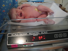 Photo of our baby girl on the scale in the delivery room