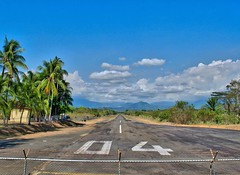 Day 311. Lone strip airport in Quepos. More palm farms all day. Humidity is crazy but have finally figured out there's just no walking after ten. Today, I had to stop in a touristy town for the midday hours. Was pretty pissed at first, seeing bubbly, fres