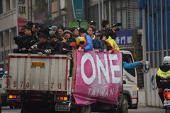 Journalists aboard a truck in a convoy of local official in Taipei the day before election day, January 15, 2016