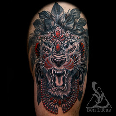 Erwins-black-grey-and-red-tribal-lion-thigh-tattoo-done-by-ben-lucas-at-eye-of-jade-in-chico-ca