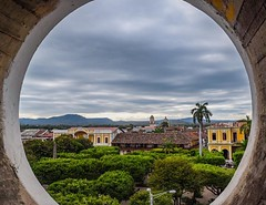 There's a shoulder-wide stairwell up the bell tower of Catedral de Granada. Near the top of the stairwell there are open portholes that frame Granada in a spectacular way. #theworldwalk #travel #nicaragua