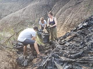 Ukuwela interns clearing plastic