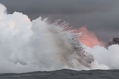 An explosion of lava occurs, as ash plume rises from sea water after lava flow was cooled on May 25, 2018 in Pahoa, Hawaii, United States. (Photo by Yichuan Cao/Sipa USA)
