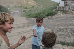Gypsy boys sharing cigarettes. Cluj Napoca, Pata Rat