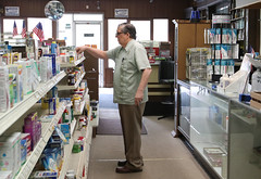 Carpenter looks at medicines in the front of the store.