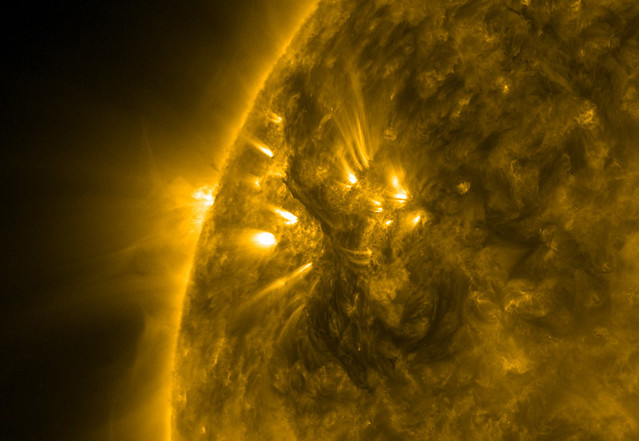 surface of the sun with flares