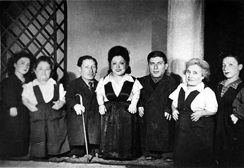 Seven dwarf siblings of the Ovitz family, black and white