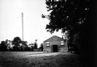 Signal Corps communications building and tower, Valonges, Cotenin Peninsula, France. Valognes is near Tamerville, northwest of Utah Beach and south of Cherbourg.