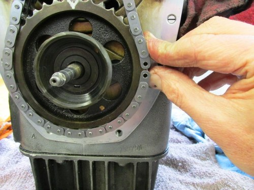 Using Sprocket Teeth to Hold Cam Chain In Place
