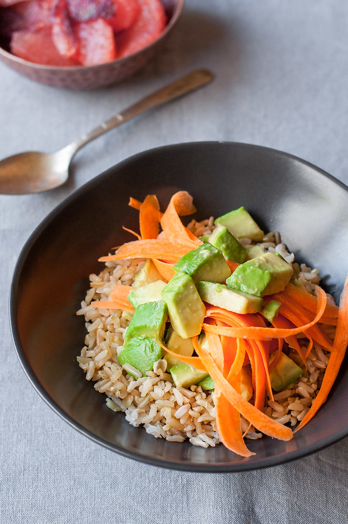 Brown rice breakfast bowl with avocado and carrot ribbon salad