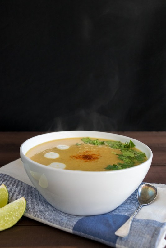 a steaming bowl of spicy cauliflower soup