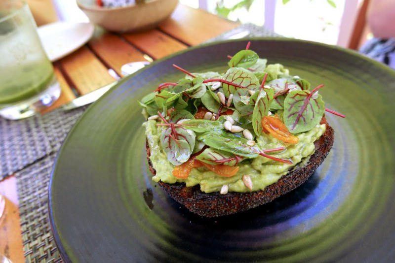 Avocado, whole wheat toast, kumquat, sunflower