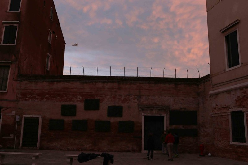 City Moment - Evening Bird Over The Barbed Wire,  Venice Ghetto