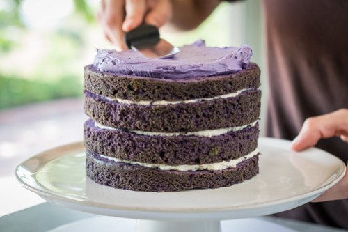 spreading the smooth ube frosting