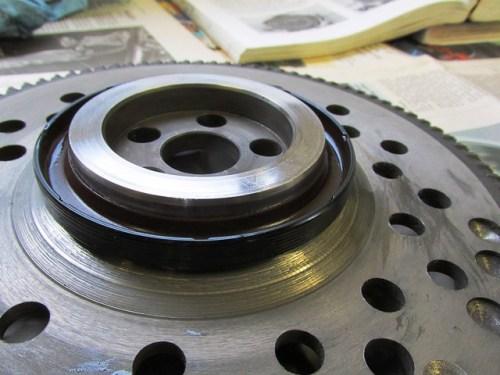 Forming Crank Rear Oil Seal on Flywheel Ring