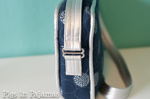 Polaris bag handle attachment