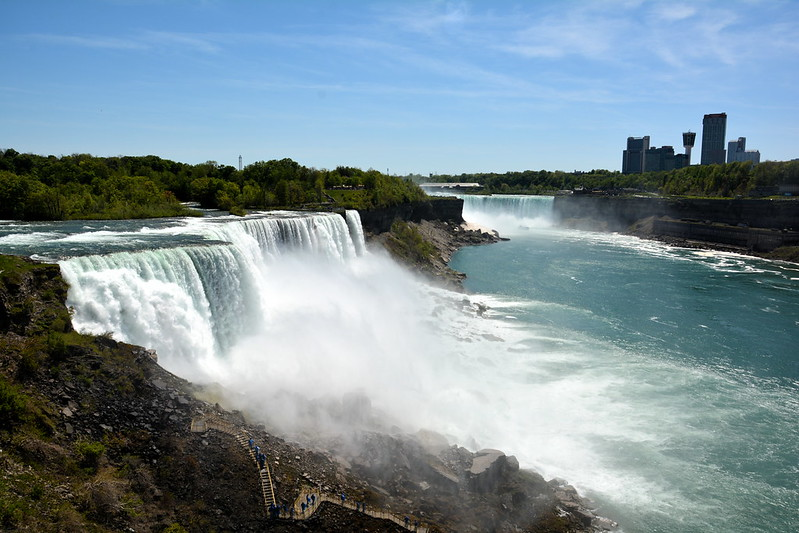 The American Falls with Horseshoe Falls in the background, and visitors