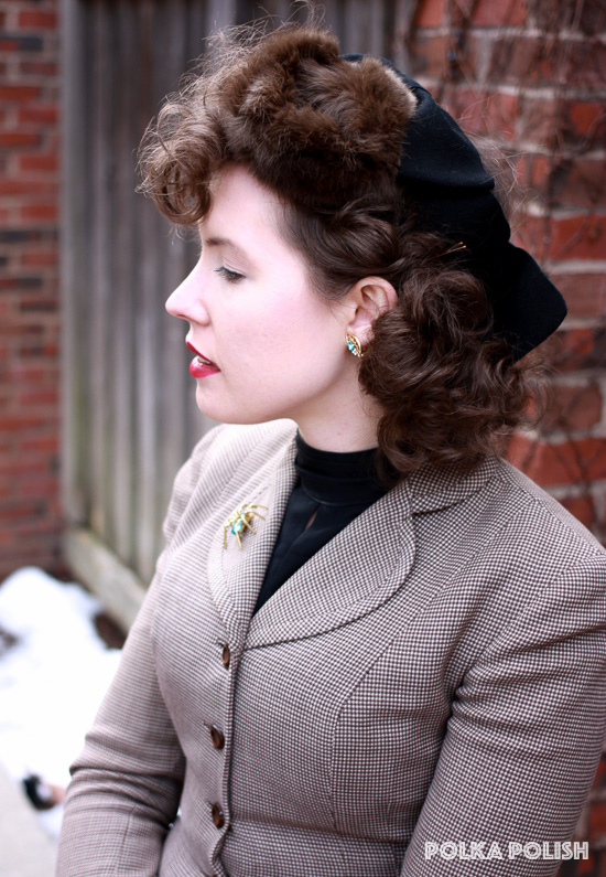 1940s vintage styled outfit with a fur tilt hat, brown checkered I. Magnin suit jacket, black blouse, and aqua rhinestone spider novelty brooch