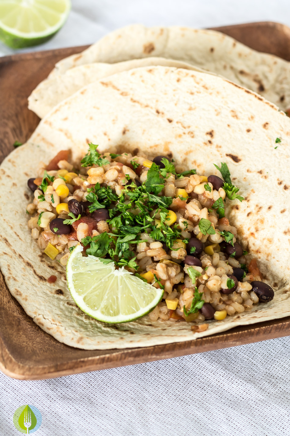 soft taco shell filled with vegan black bean and barley filling