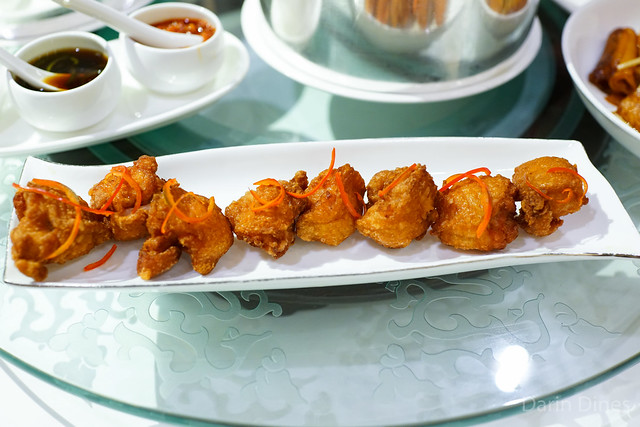 Golden-fried chicken wings with garlic and preserved bean curd paste