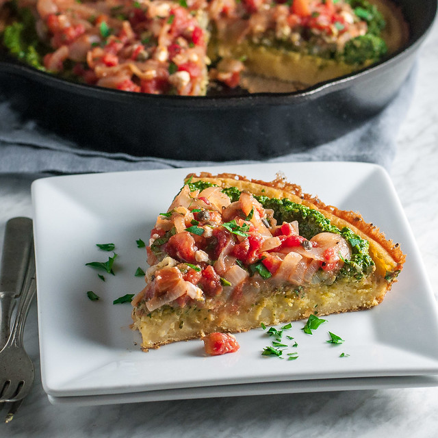 The BEST deep dish pizza when you're craving something healthy AND satisfying. Sturdy, no-knead chickpea flour crust spread with creamy vegan pesto and tomato-leek sauce.