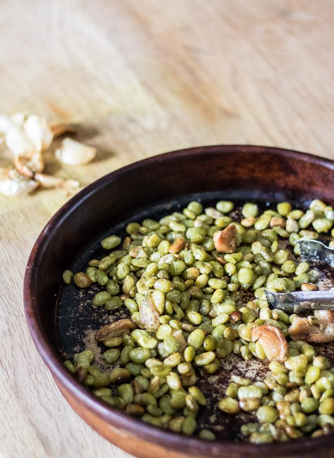 roasted lima beans, roasted garlic in stoneware dish