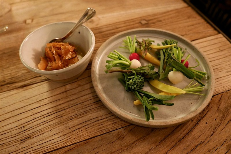 Bagna càuda dip made with lovage cream, garlic, olive oil, topped with shaved cured albacore and house grown vegetables