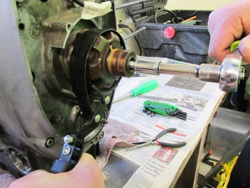Oil Filter Wrench Securing Rotor While Tightening Rotor Removal Bolt
