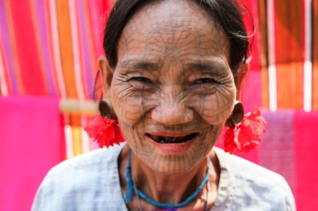 Weaver. Chin woman with facial tattoos.