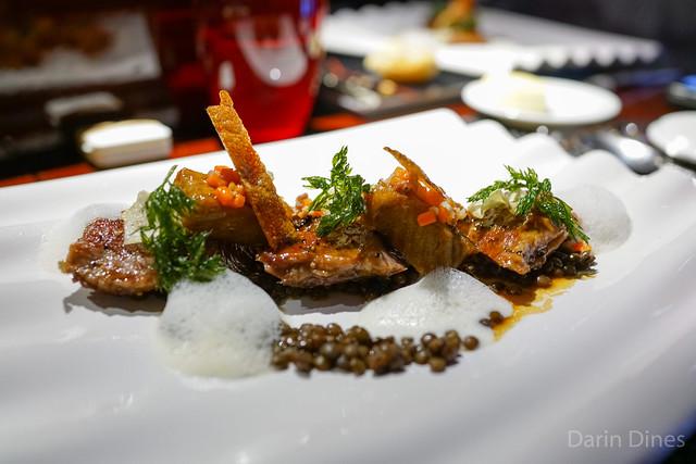 "Le Cochon Iberique roasted iberico pork ""pluma"" with crispy pork belly and lentil beans"