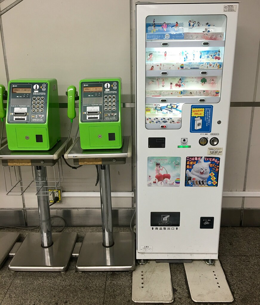 Fuchiko - Edge of the cup vending machine at Akihabara. コップのフチ子
