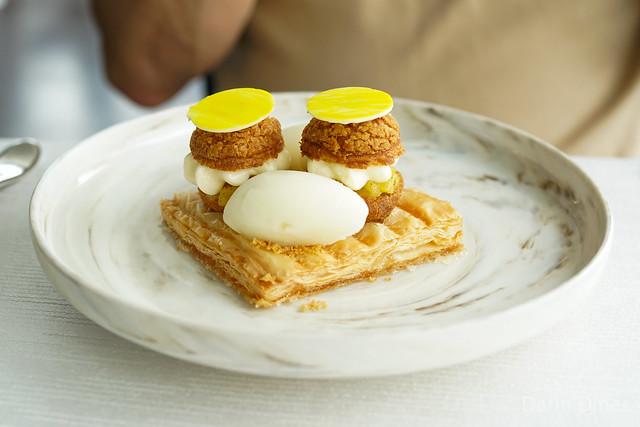Saint Honoré caramelised puff pastry, roasted pineapple, yuzu cream, citrus sorbet