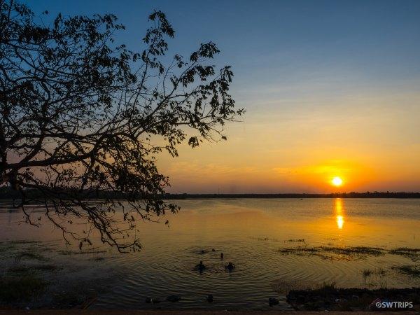 Bathers at Sunset in Basawakkulama Water Tank - Anuradhapura, Sri Lanka.jpg