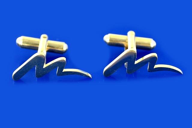 spinki pozłacane z logo firmy  MIRBUD