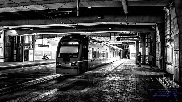 As A Sound Transit Light Rail Departs International District Station in Dark & Light...