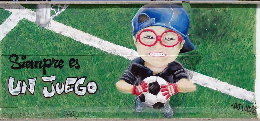 Graffiti pintura mural sobre el deporte e igualdad en Polideportivo Alcazar de San Juan Ciudad Real 02