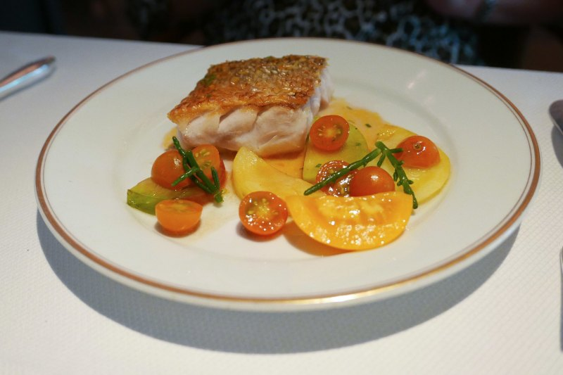 Retour de Pêche, tilefish cooked with its scales, warm tomato vinaigrette, sea beans