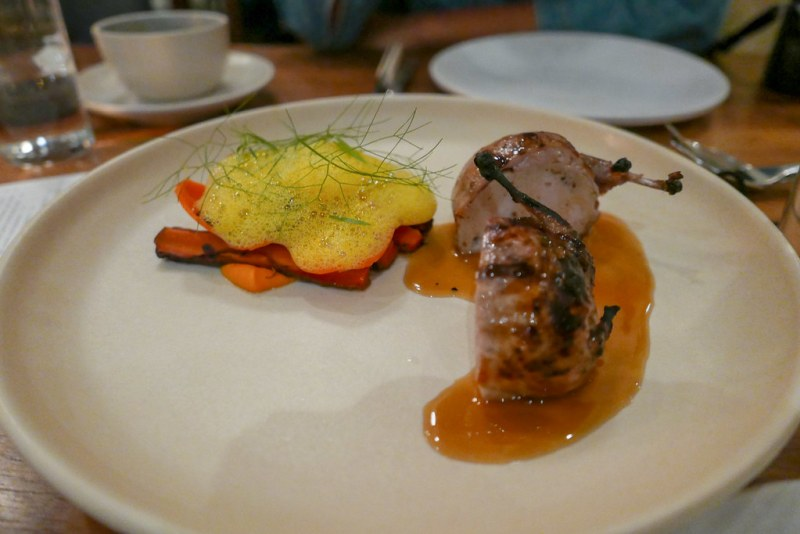 Sausage stuffed quail with ember roasted carrots and tarragon