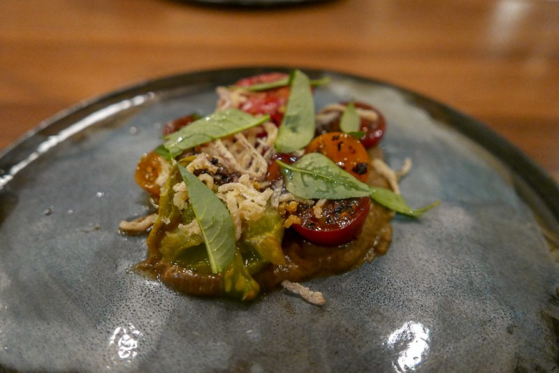 Tomato 'ice box' salad with burnt eggplant, vietnamese coriander, and shallot $18
