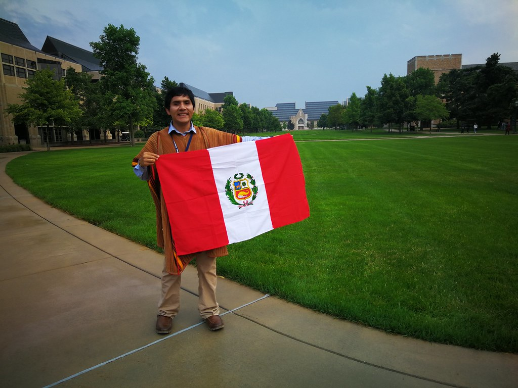 With my traditional poncho and Peruvian flag