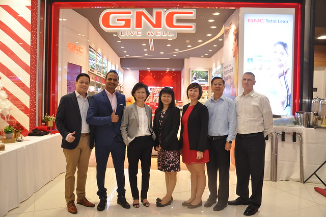 GNC Philippines Marketing Manager Edwin Angeles, General Manager Vasanth Raj, ONI Global Group CEO Cynthia Poa, Group COO Jennifer Goh, Head for Marketing Evelyn Teo, Head for Operations Ghim Pin Tan, and GNC Intl Marketing Manager Ken Tillett