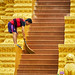 Man sweeping steps of Temple in Phnom Penh Cambodia