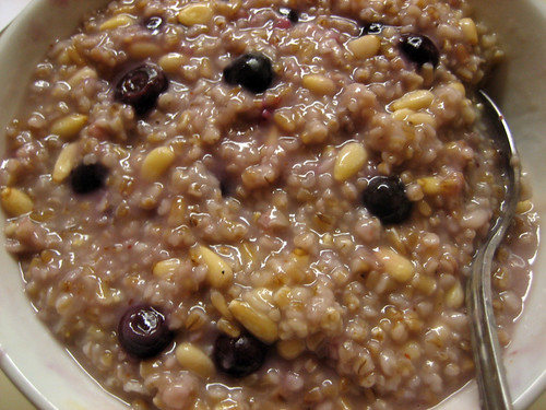 steel-cut oatmeal with blueberries and pine nuts