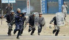 Police fire teargas shells at demonstrators in Birjung, about 200 km (124 miles) south of Kathmandu, February 15, 2008.